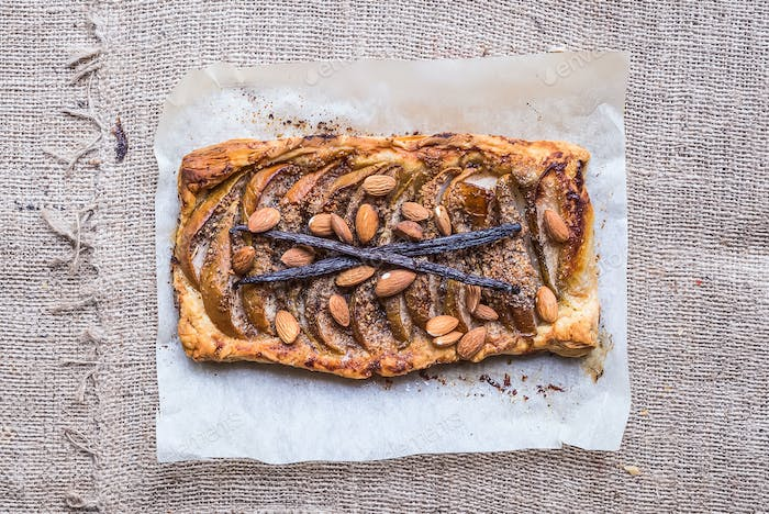 Pear square galette with almond and vanilla over a sackcloth sur