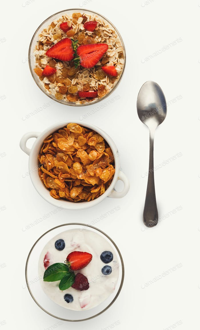 Set of bowls with breakfast meals, isolated