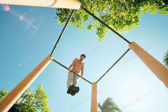 Adult Man Training Chest Muscles Doing Calisthenics Workout Outdoors