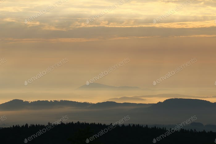 Sunrise in the mountains - hills in morning mist