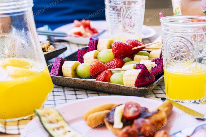 Close up of table with fruits food - colorful healthy lifestyle diet weight loss food -