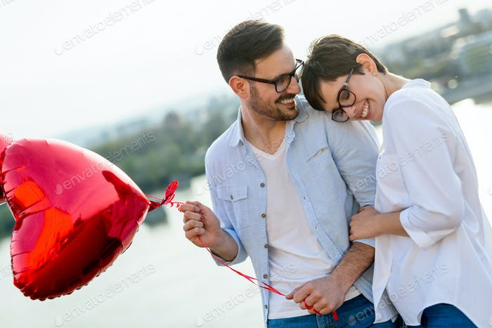 Young couple in love dating and smiling outdoor