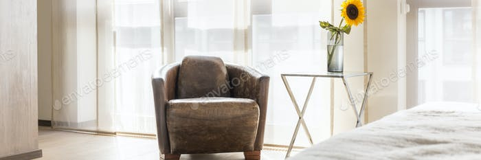 Light bedroom with armchair