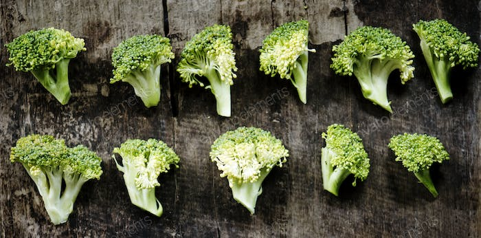 Aerial view of fresh cut broccoli on wooden background