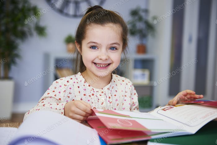 Portrait of smiling child studying at home