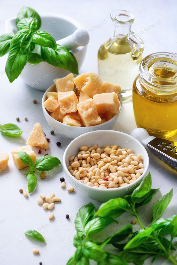 Ingredients for homemade pesto - basil, lemon, parmesan, pine nuts, garlic, olive oil and salt on