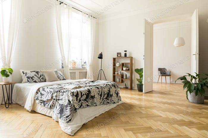 Stylish apartment interior with white walls and herringbone wood