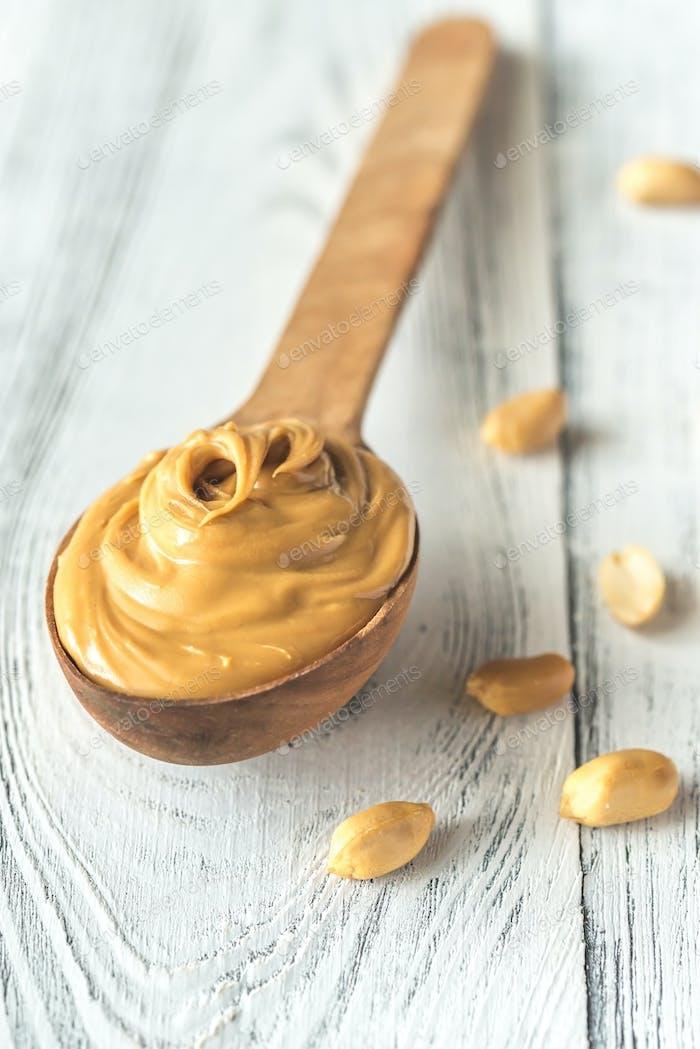 Wooden spoon of peanut butter