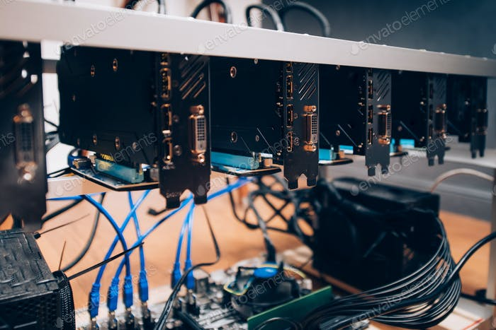Cryptocurrency mining rig, creating bitcoin. Details of graphics cards in modern industry