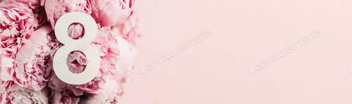 8 March. Happy Women's Day. Creative layout. Pink peony flowers and digit eight 8. Birthday