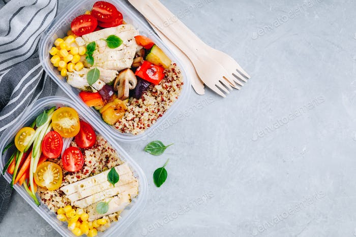 Meal prep l containers with quinoa, grilled and fresh vegetables and chicken