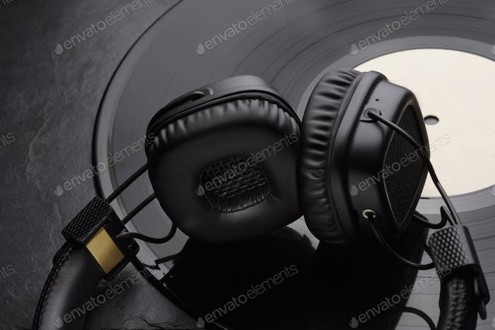 Over or on-ear headphones on vinyl record.