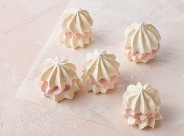 meringue cakes on pink background