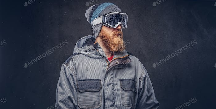 Portrait of a redhead snowboarder posing at a studio
