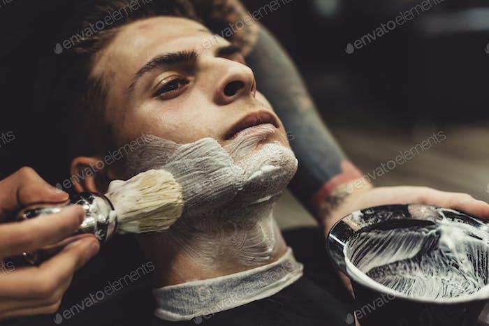 Client de rasage de barbier