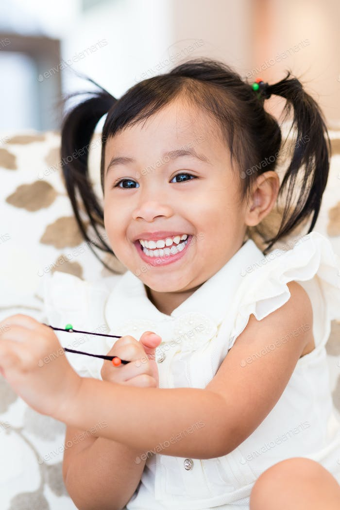 Excited little girl play with other