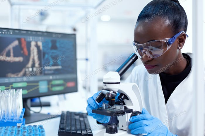 African pharmacology researcher analysing chemical substance