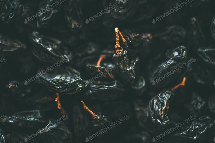 Flat-lay of black dried raisins, top view, close-up