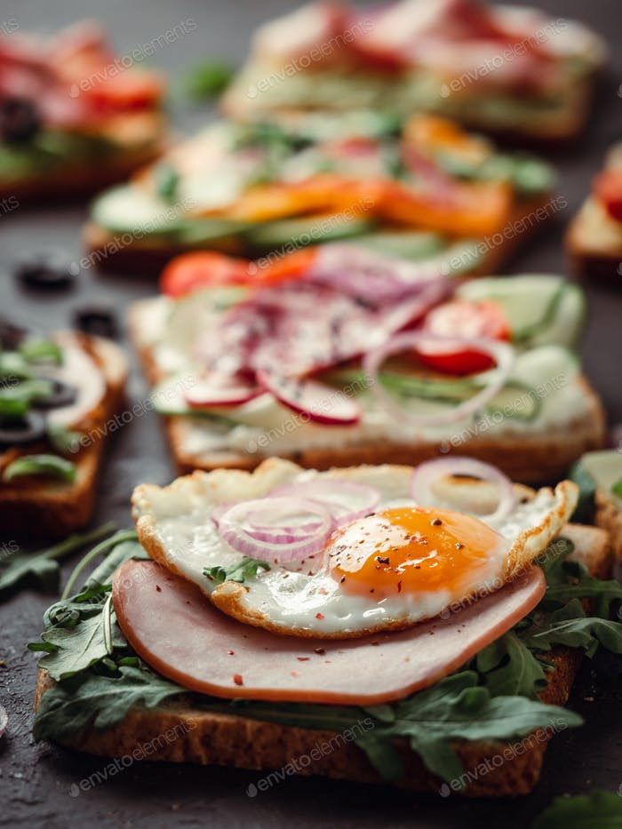 sandwiches with meat, egg, vegetables and herbs