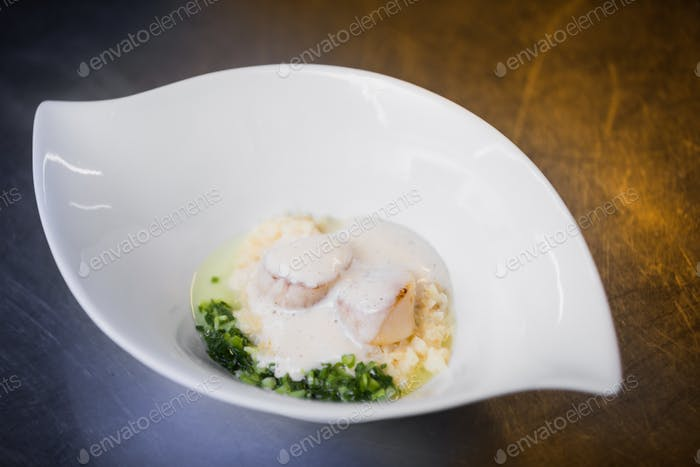Bowl with�scallop in cream
