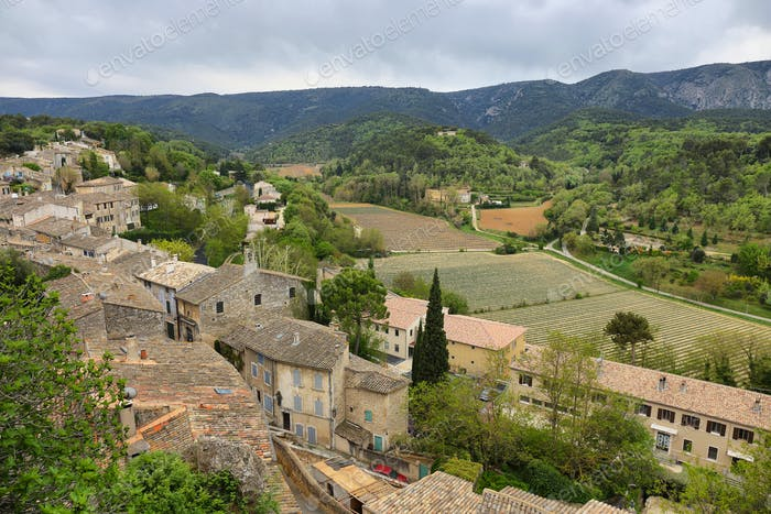 View on rooftops and Luberon valley in Menerbes, France