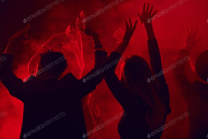 Crowd Dancing in Red Nightclub