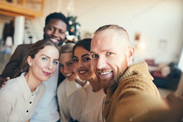 Young People Taking Selfie at Christmas Party