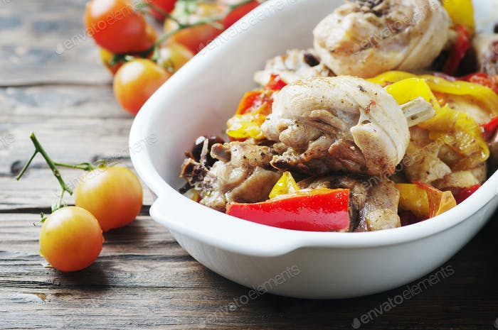 Cooked chicken with tomato, oilve and paprika