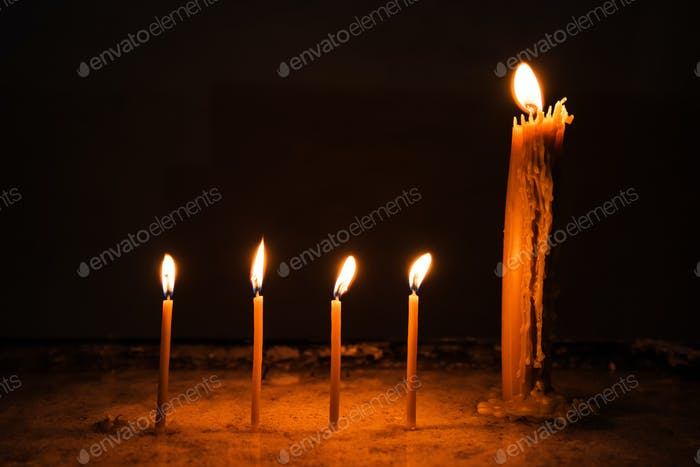 Wax church candles burning