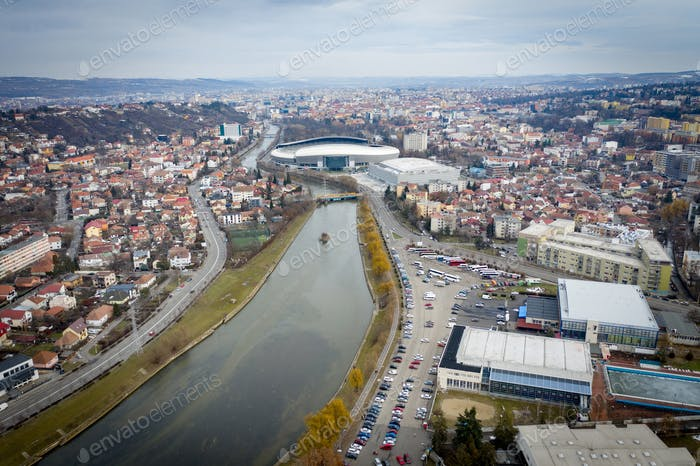 Aerial above view of river crossing the city. Drone shot of Cluj Napoca, Romania