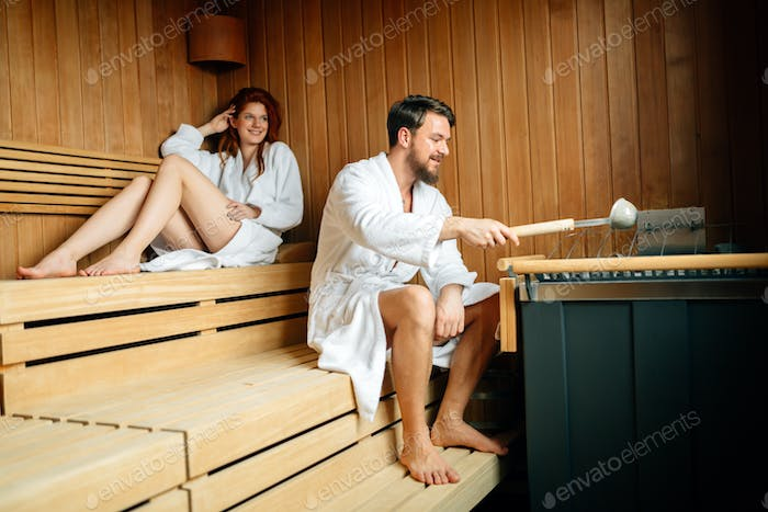 Couple resting in sauna