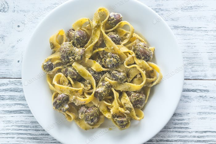 Portion of creamy mushroom pasta with pesto