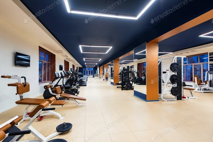 New fitness machines in modern gym interior