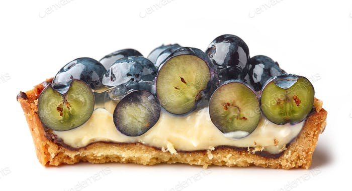 half of blueberry tart on white background