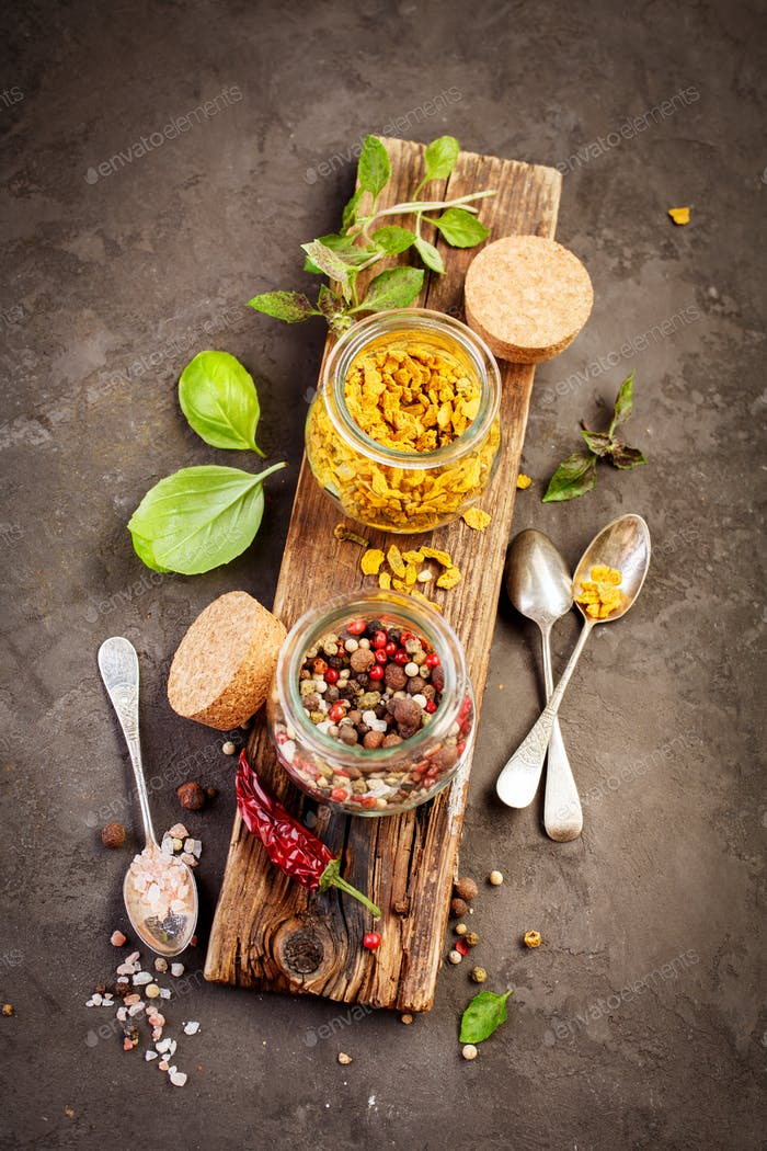 Pepper spice mix, ingredients for cooking on a rustic  background.