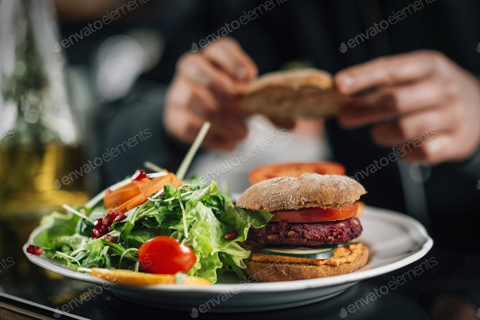 Chef Making Vegan Burgers in a Restaurant Kitchen