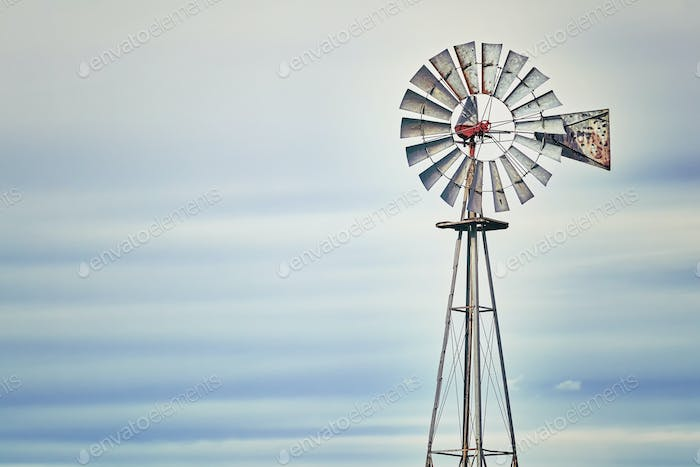 Vintage toned windmill tower, American wild west symbol.
