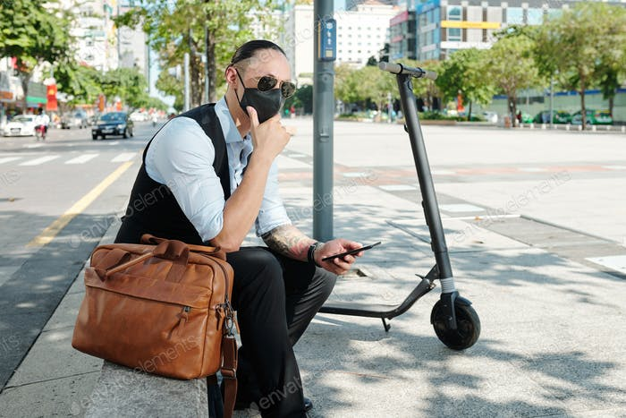Businessman in protective mask