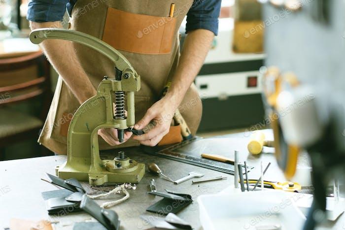 Leather workshop owner