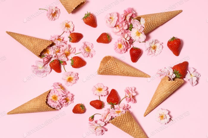 Ice cream cones with strawberries and pink roses