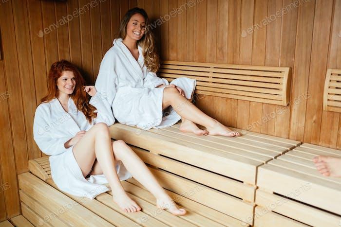 Beautiful women enjoying sauna treatment