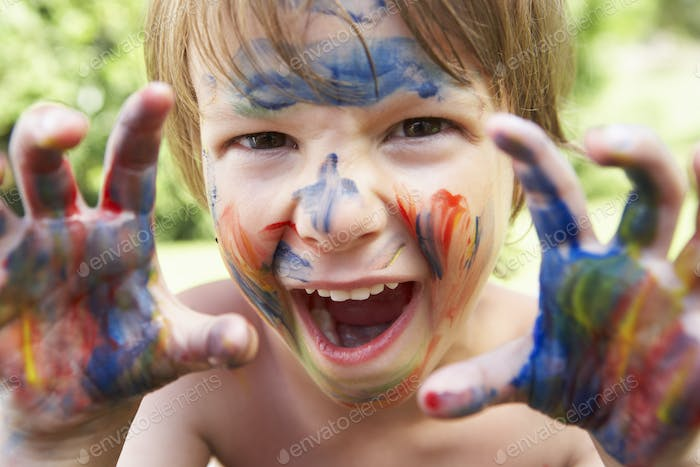 Portrait Of Boy With Painted Face and Hands