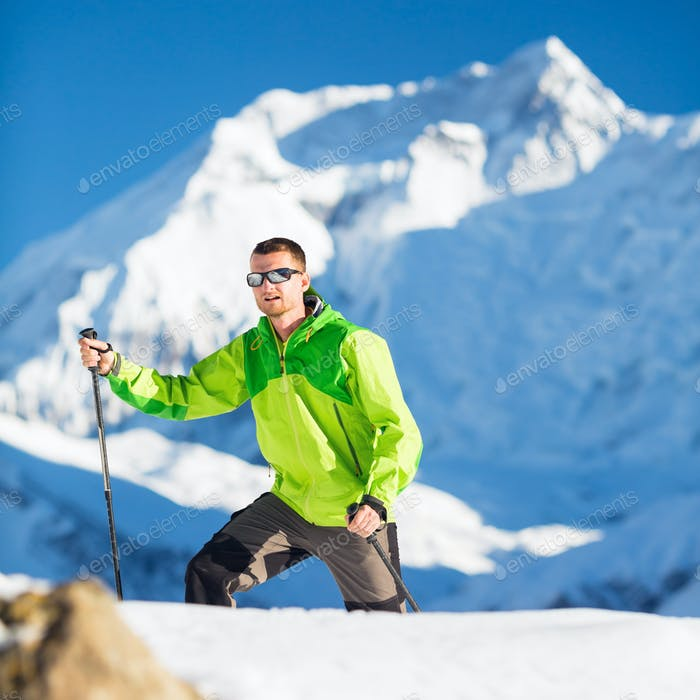Man climbing exploring winter mountains