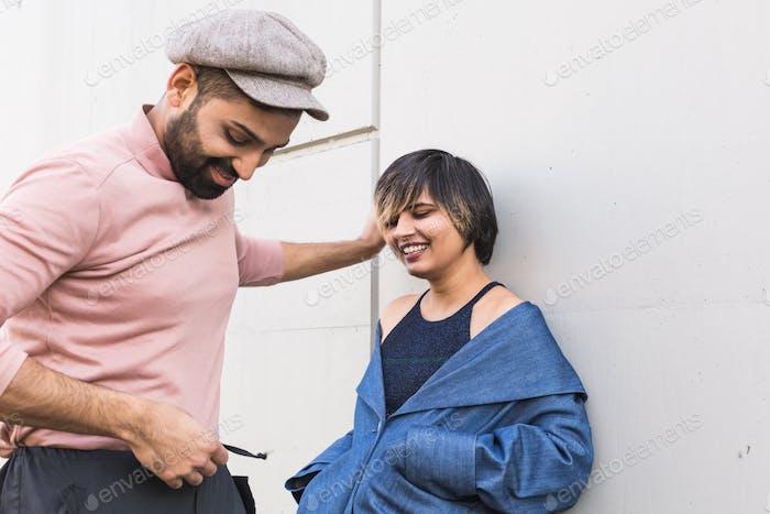 Indian couple posing in an urban context