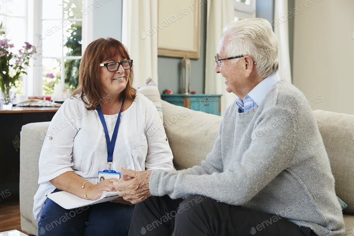 Female Support Worker Visits Senior Man At Home