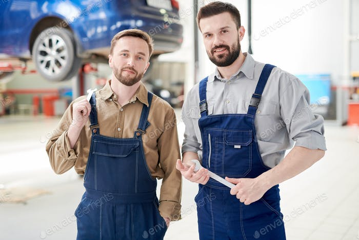 Two Workers Posing in Car Service Shop