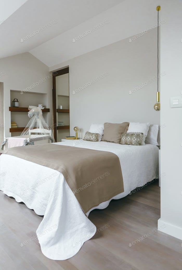 Bedroom with double bed and cot