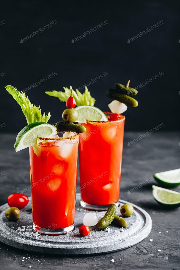 Bloody Mary Cocktail in glasses with garnishes.