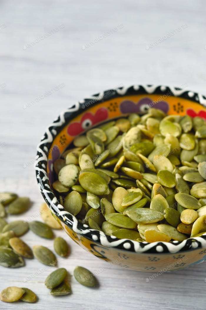 Pumpkin seeds in a ceramic bowl
