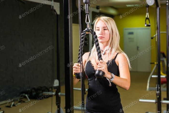 Thumbnail for beautiful muscular fit woman exercising building muscles in gym
